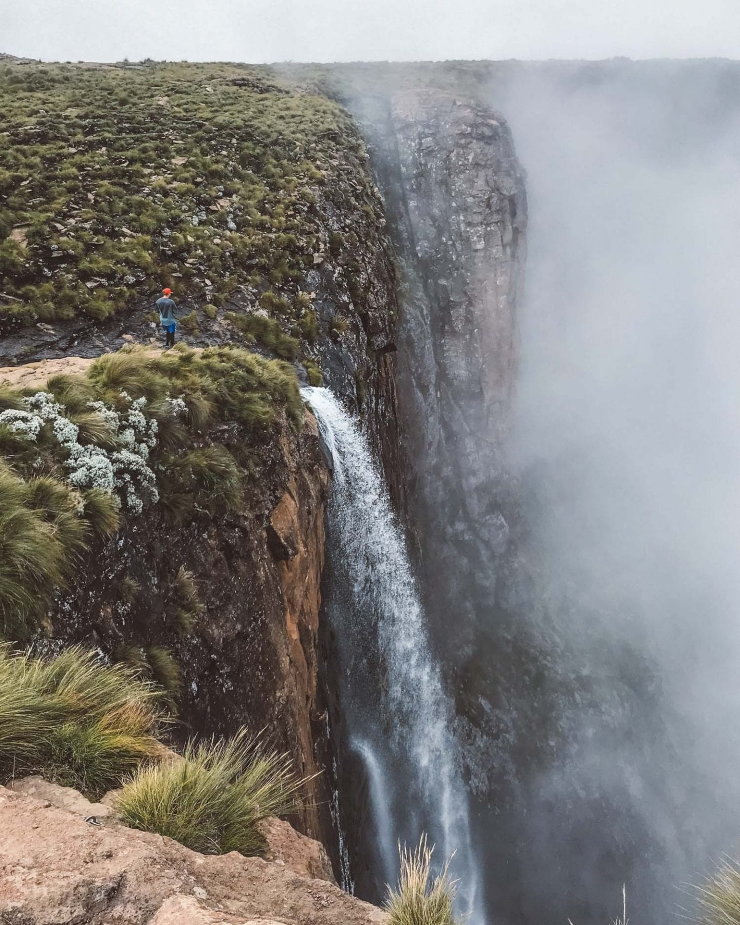 man on top of tugela falls