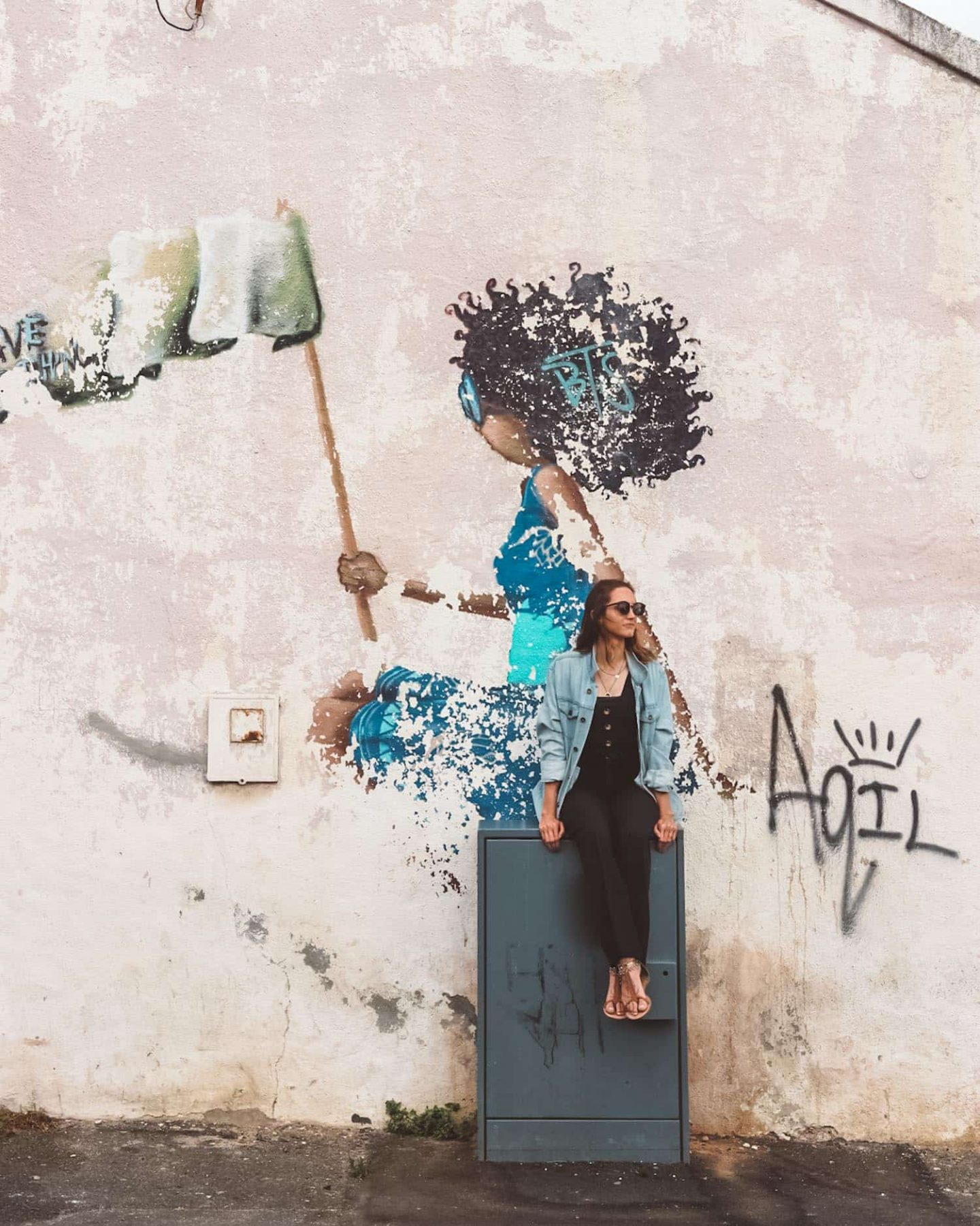 girl posing with street art in woodstock