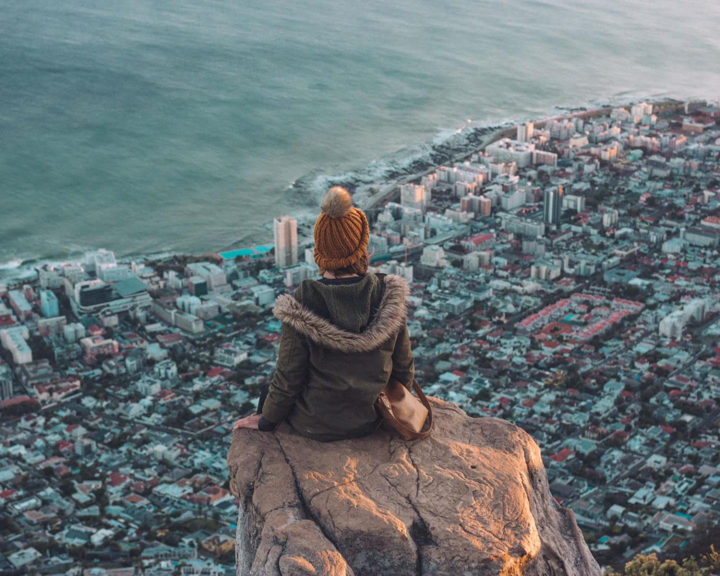 girl on top of lions head