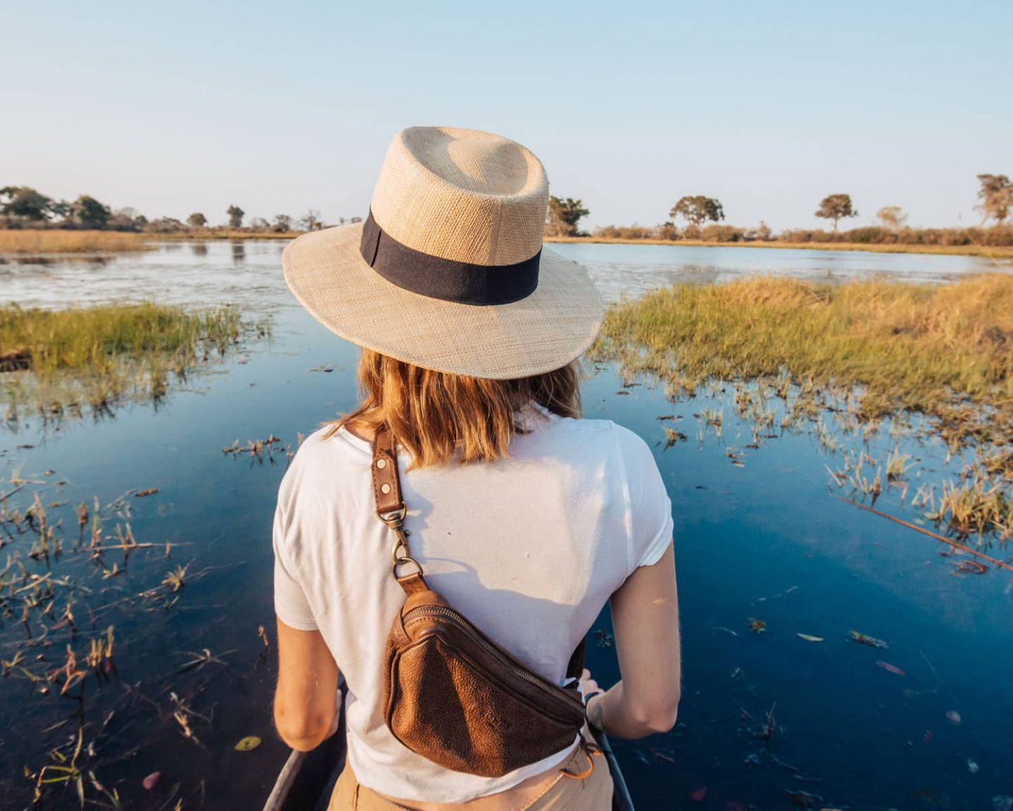 girl on mokoro safari in the okavango delta