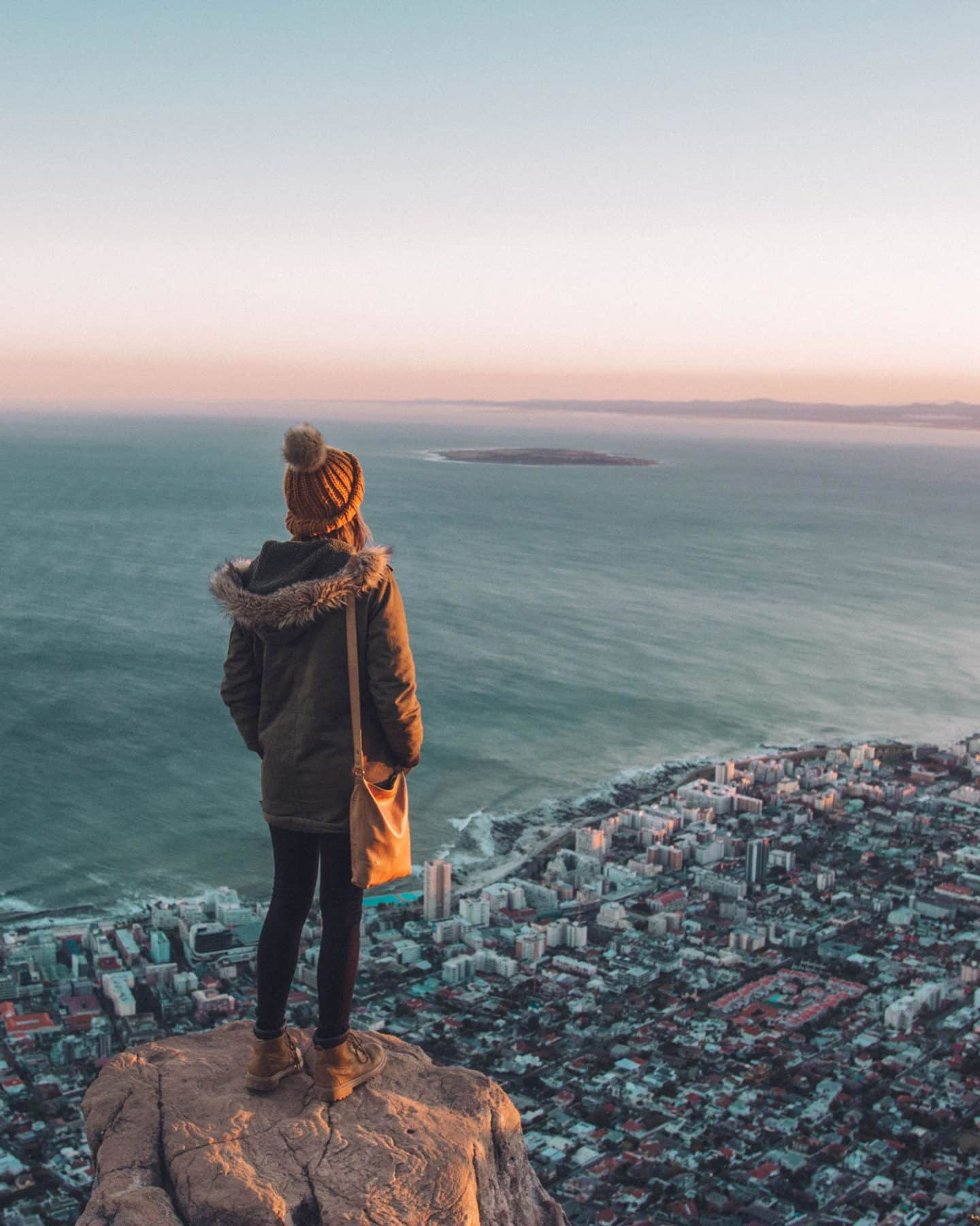 girl standing on top of lion's head