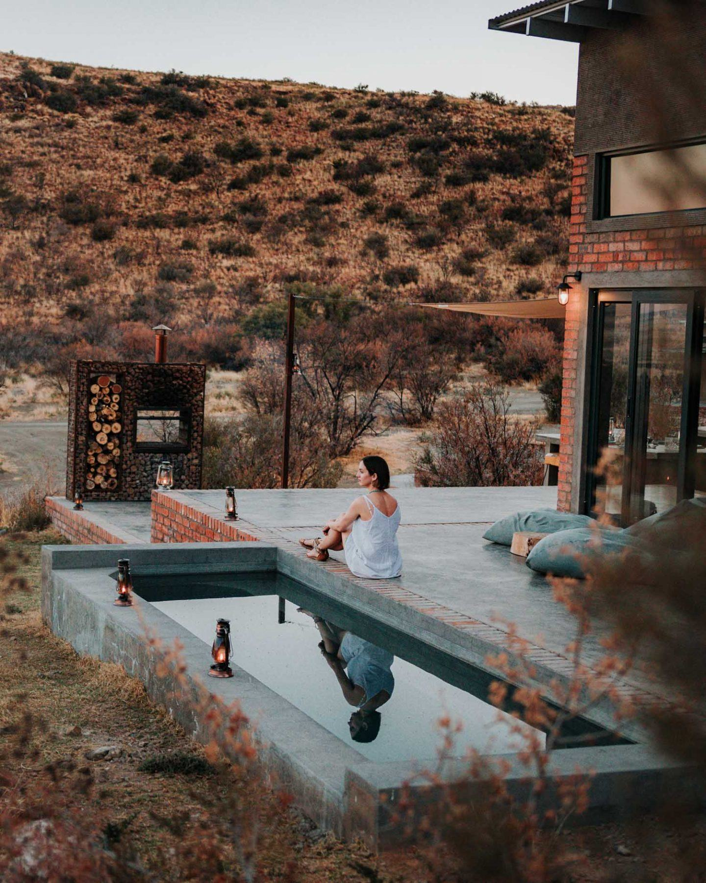 girl sitting at pool edge