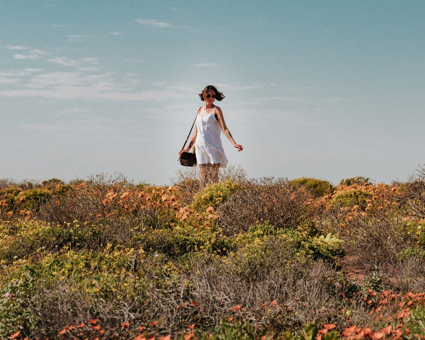 girl in namaqualand flowers