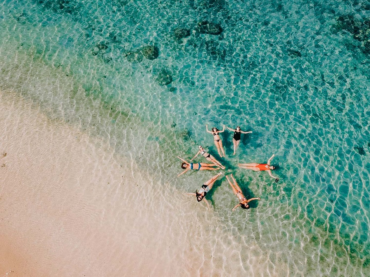 drone shot of girls on the beach at reunion island