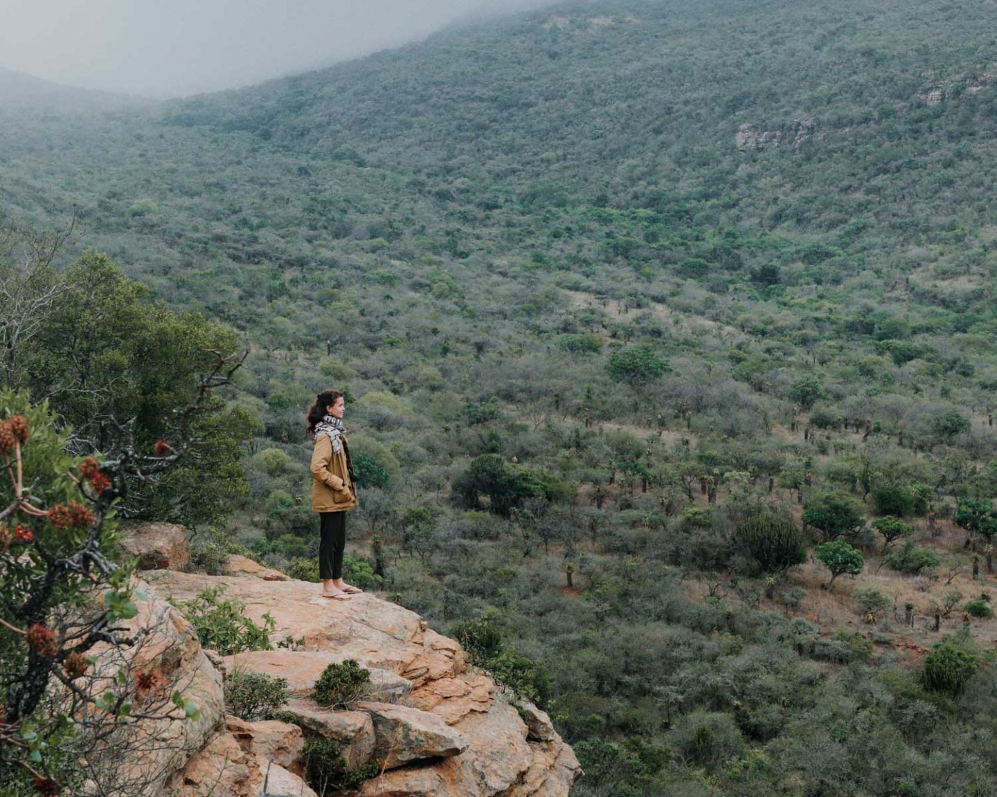 girl standing at viewpoint in babanango valley lodge